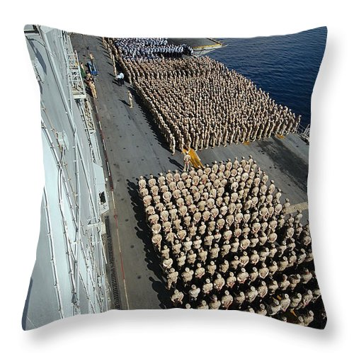 Color Image Throw Pillow featuring the photograph Crew Aboard The Amphibious Assault Ship by Stocktrek Images