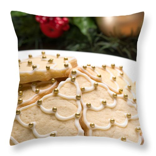 Glazed Throw Pillow featuring the photograph Decorated Cookies In Festive Setting by U Schade