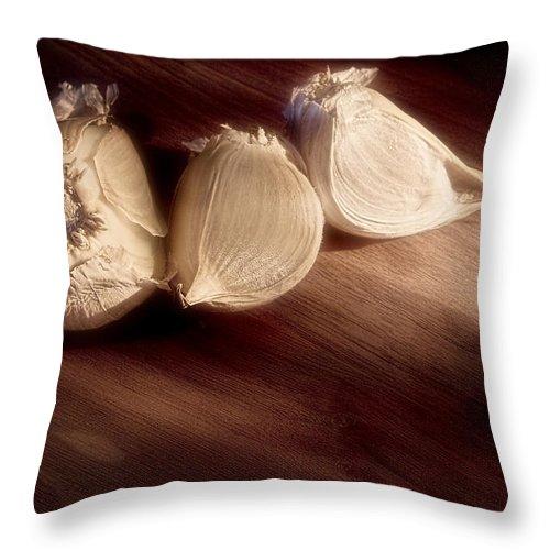 Garlic Throw Pillow featuring the photograph Garlic Cloves by Tom Mc Nemar