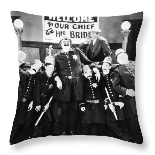 1910s Throw Pillow featuring the photograph Keystone Kops by Granger