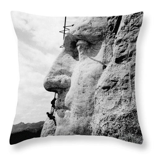 1930's Throw Pillow featuring the photograph Men Working On Mt. Rushmore by Underwood Archives