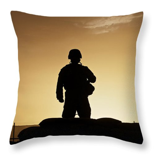 Afghanistan Throw Pillow featuring the photograph Partially Silhouetted U.s. Marine by Terry Moore