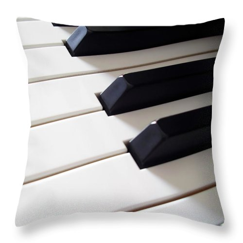 Acoustic Throw Pillow featuring the photograph Piano Keys by Carlos Caetano