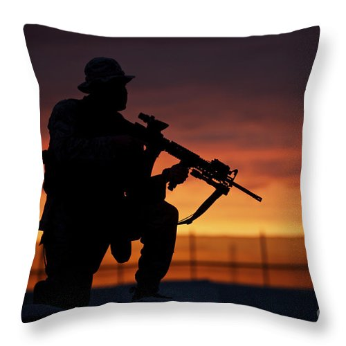 Marine Throw Pillow featuring the photograph Silhouette Of A U.s Marine On A Bunker by Terry Moore