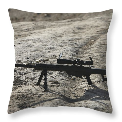 Afghanistan Throw Pillow featuring the photograph The Barrett M82a1 Sniper Rifle by Terry Moore