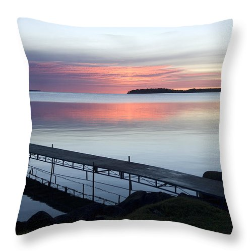 Walker Throw Pillow featuring the photograph The Dock At Traders Bay Lodge On Leech by Joel Sartore