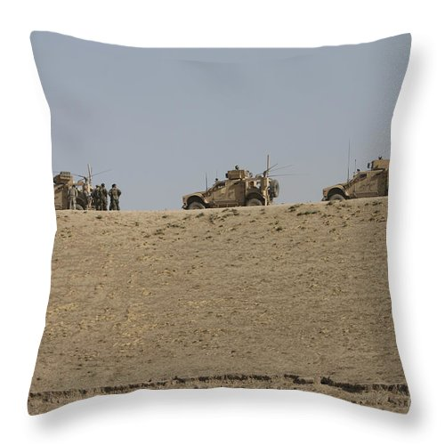Armor Throw Pillow featuring the photograph Three M-atvs Guard The Top Of The Wadi by Terry Moore
