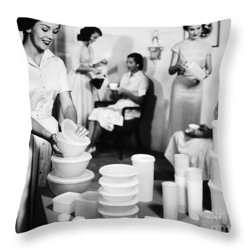 1950s Throw Pillow featuring the photograph TUPPERWARE PARTY, 1950s by Granger