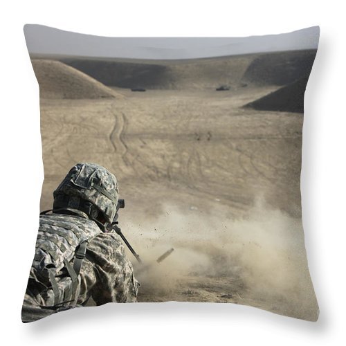 Operation Enduring Freedom Throw Pillow featuring the photograph U.s. Army Soldier Fires A Barrett M82a1 by Terry Moore