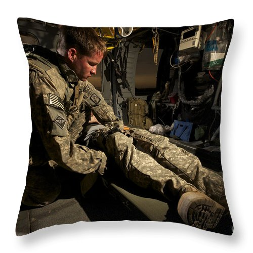 Us Army Throw Pillow featuring the photograph U.s. Army Specialist Practices Giving by Terry Moore