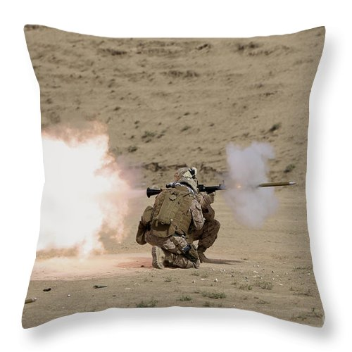 Afghanistan Throw Pillow featuring the photograph U.s. Marine Fires A Rpg-7 Grenade by Terry Moore