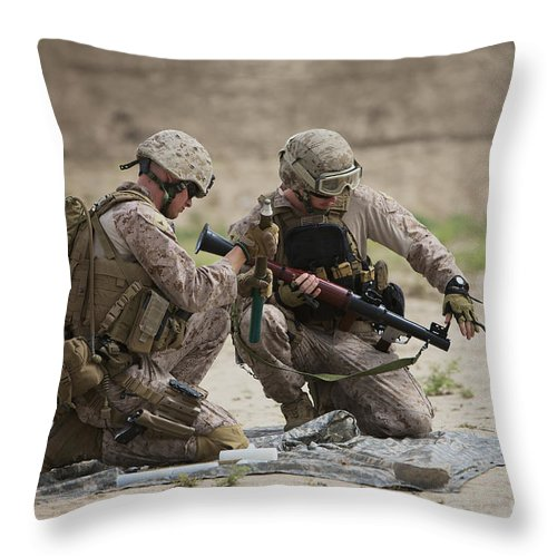 Kunduz Throw Pillow featuring the photograph U.s. Marines Prepare A Fragmentation by Terry Moore
