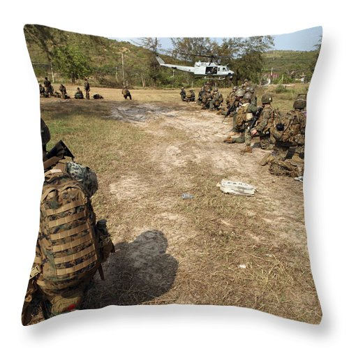 Marine Expeditionary Unit Throw Pillow featuring the photograph U.s. Marines Provide Security by Stocktrek Images