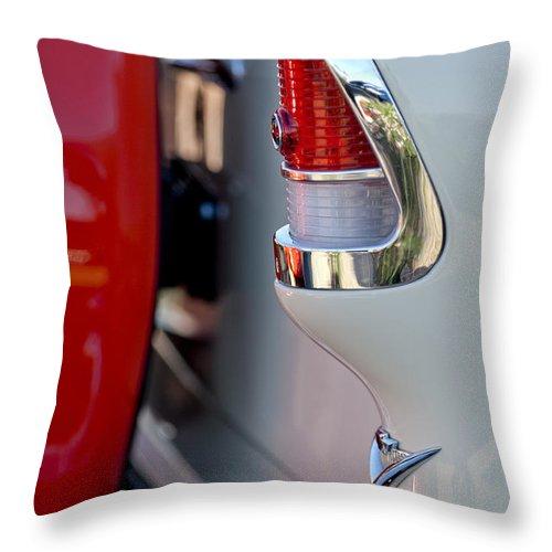 1955 Chevrolet Belair Throw Pillow featuring the photograph 1955 Chevrolet Belair Taillight Emblem by Jill Reger