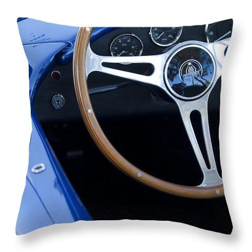 1965 Cobra Sc Throw Pillow featuring the photograph 1965 Cobra Sc Steering Wheel 2 by Jill Reger