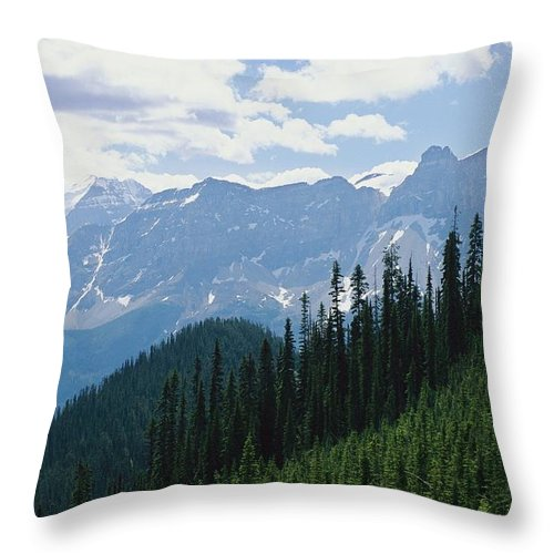 North America Throw Pillow featuring the photograph A Scenic View Of The Rocky Mountains by Michael Melford