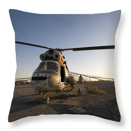 Aviation Throw Pillow featuring the photograph An Iraqi Helicopter Sits On The Flight by Terry Moore