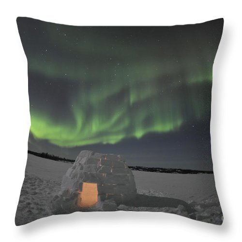 Yellowknife Throw Pillow featuring the photograph Aurora Borealis Over An Igloo On Walsh by Jiri Hermann