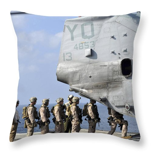 Warship Throw Pillow featuring the photograph Marines Board A Ch-46e Sea Knight by Stocktrek Images
