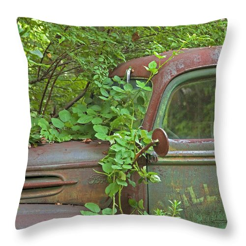 Rustbuckets Throw Pillow featuring the photograph Overgrown Rusty Ford Pickup Truck by John Stephens