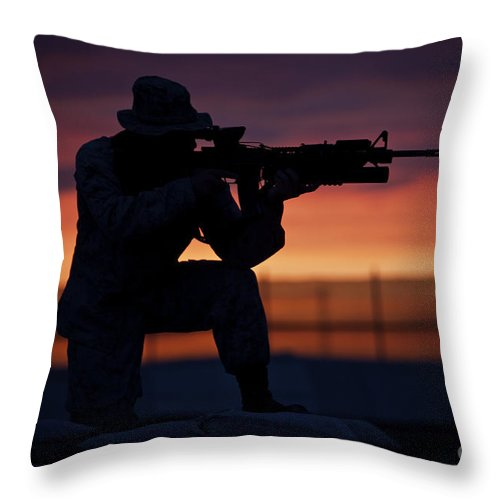 Afghanistan Throw Pillow featuring the photograph Silhouette Of A U.s Marine On A Bunker by Terry Moore