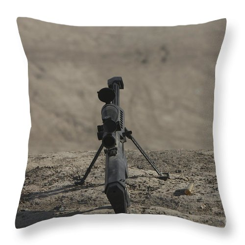 Kunduz Throw Pillow featuring the photograph The Barrett M82a1 Sniper Rifle by Terry Moore