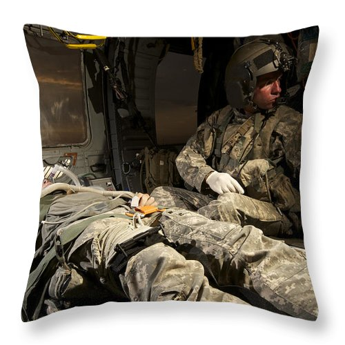 Medical Support Throw Pillow featuring the photograph U.s. Army Specialist Practices Giving by Terry Moore