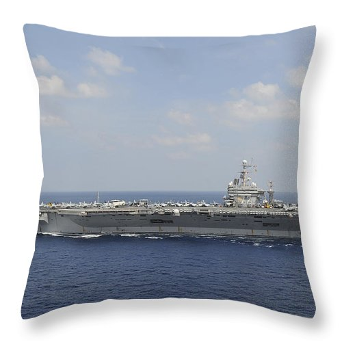 Blue Throw Pillow featuring the photograph Uss Abraham Lincoln Transits The Indian by Stocktrek Images