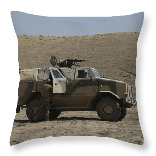 Operation Enduring Freedom Throw Pillow featuring the photograph The German Army Atf Dingo Armored by Terry Moore