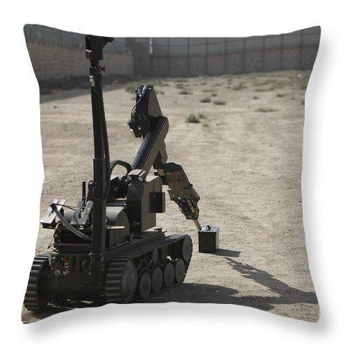 Robot Throw Pillow featuring the photograph The Teodor Heavy-duty Bomb Disposal by Terry Moore