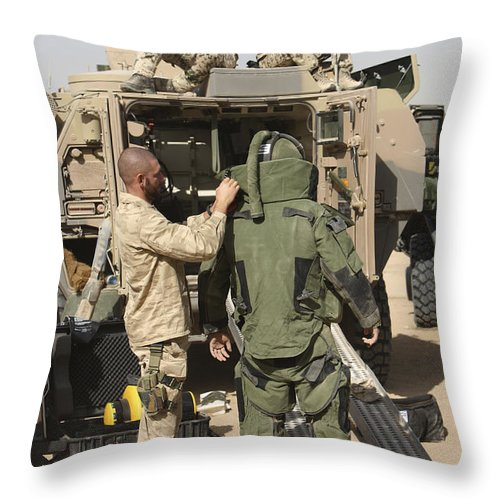 Afghanistan Throw Pillow featuring the photograph A U.s. Marine Gets Suited by Terry Moore