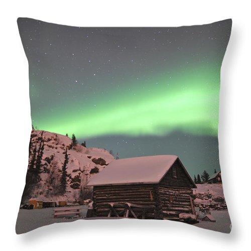 Yellowknife Throw Pillow featuring the photograph Aurora Borealis Over A Cabin, Northwest by Jiri Hermann