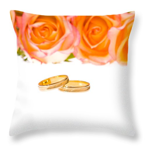 Backgrounds Throw Pillow featuring the photograph 4 Red Yellow Roses And Wedding Rings Over White by U Schade