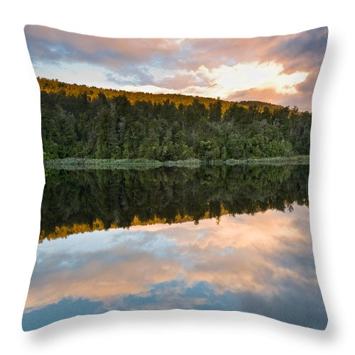 Background Throw Pillow featuring the photograph Sunrise Above A Lake On A Wind Still Morning by U Schade