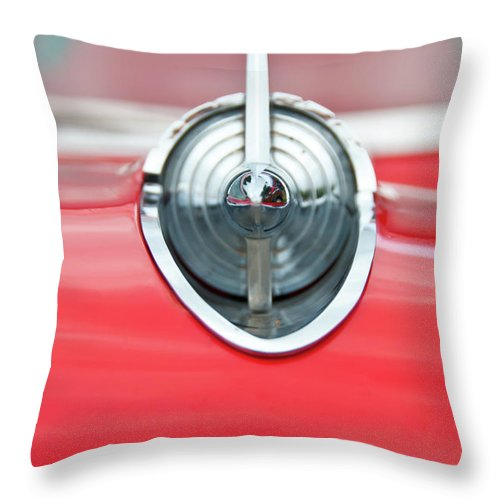 Automobile Throw Pillow featuring the photograph '57 Chevy Hood Ornament 8508 by Guy Whiteley