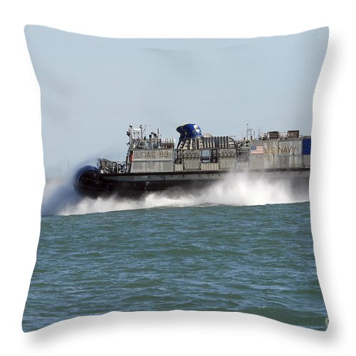 Exercise Bold Alligator Throw Pillow featuring the photograph A Landing Craft Air Cushion Prepares by Stocktrek Images