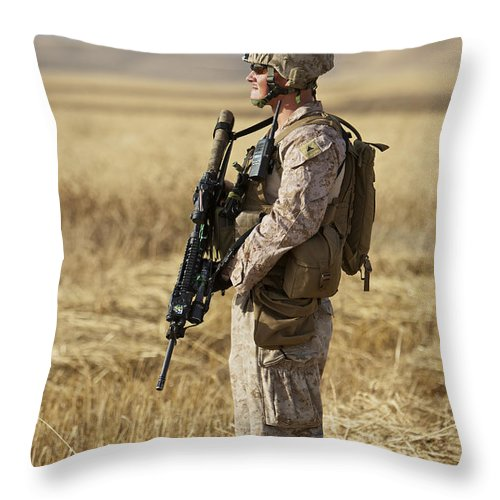 Ballistic Armor Throw Pillow featuring the photograph U.s. Marine Patrols A Wadi Near Kunduz by Terry Moore