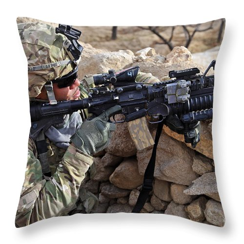 Us Army Throw Pillow featuring the photograph U.s. Army Soldier Provides Security by Stocktrek Images