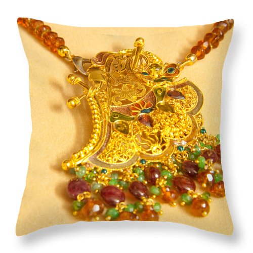 Jewel Throw Pillow featuring the photograph A Beautiful Intricately Carved Gold Pendant Hanging From A Semi-precious Stone Chain by Ashish Agarwal