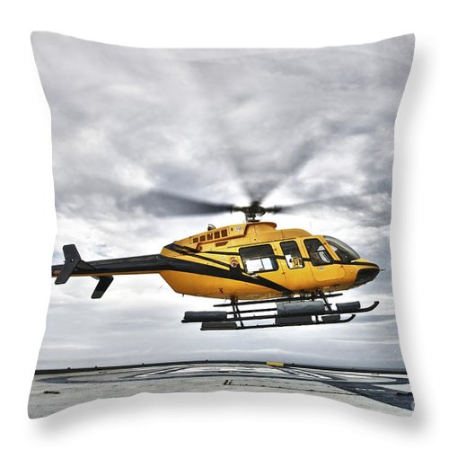 Helicopter Throw Pillow featuring the photograph A Bell 407 Utility Helicopter Prepares by Terry Moore