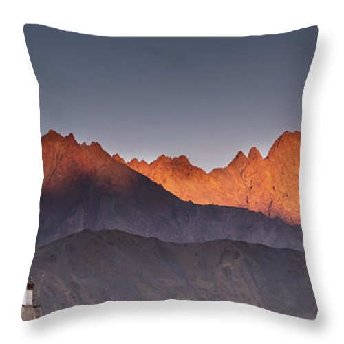 Blue Sky Throw Pillow featuring the photograph A Building On A Rock Ledge With by David DuChemin