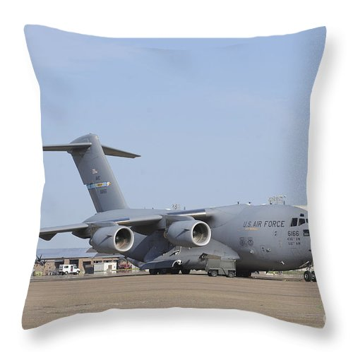 Military Throw Pillow featuring the photograph A C-17 Globemaster IIi Parked by Stocktrek Images
