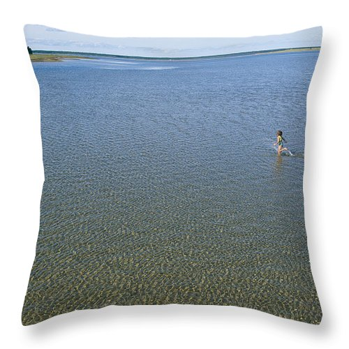 Peoples Throw Pillow featuring the photograph A Child Running Through The Water by Michael S. Lewis