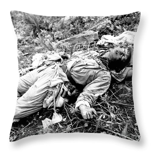 Horizontal Throw Pillow featuring the photograph A Chinese Soldier Killed by Stocktrek Images