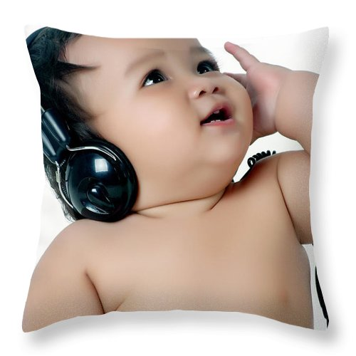 Baby Throw Pillow featuring the photograph A Chubby Little Girl Listen To Music With Headphones by Antoni Halim