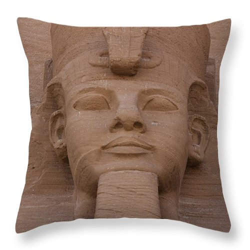 Abu Simbel Throw Pillow featuring the photograph A Close View Of The Face Of Ramses IIs by Taylor S. Kennedy