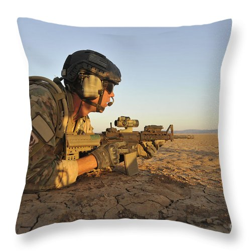 Holding Throw Pillow featuring the photograph A Combat Rescue Officer Provides by Stocktrek Images