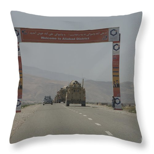 Afghanistan Throw Pillow featuring the photograph A Convoy Of Cougar Mraps Driving by Terry Moore