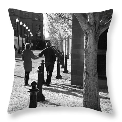 Couple Throw Pillow featuring the photograph A Couple Walking Together Holding Hands Downtown Asheville by Gray Artus