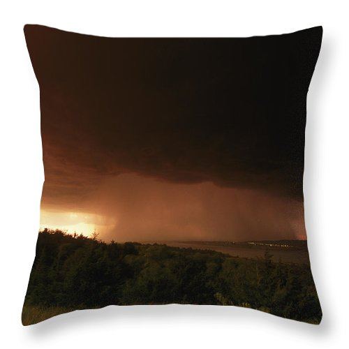 Outdoors Throw Pillow featuring the photograph A Dark Cloud With Heavy Rain Moves by Carsten Peter